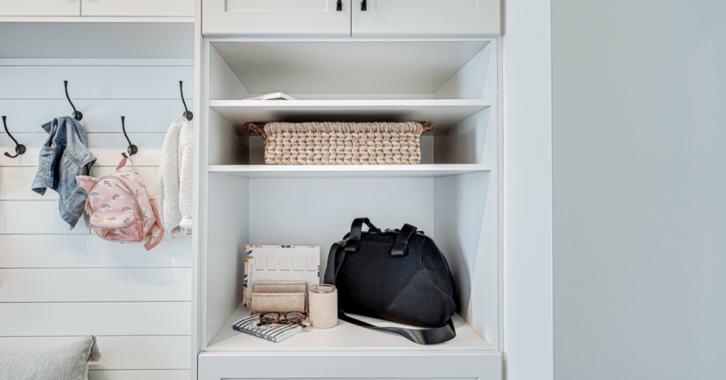 Open shelf in a custom mudroom with daily use items stored on it.